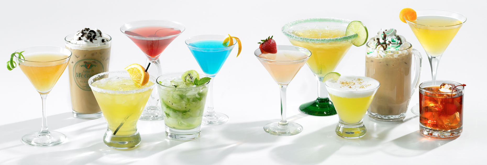 Group of cocktails with garnishes